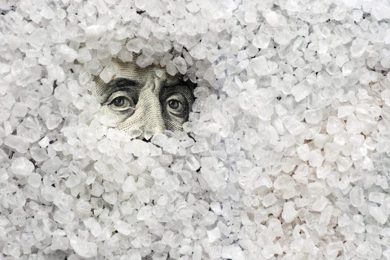 Sea salt crystals on one hundred dollars