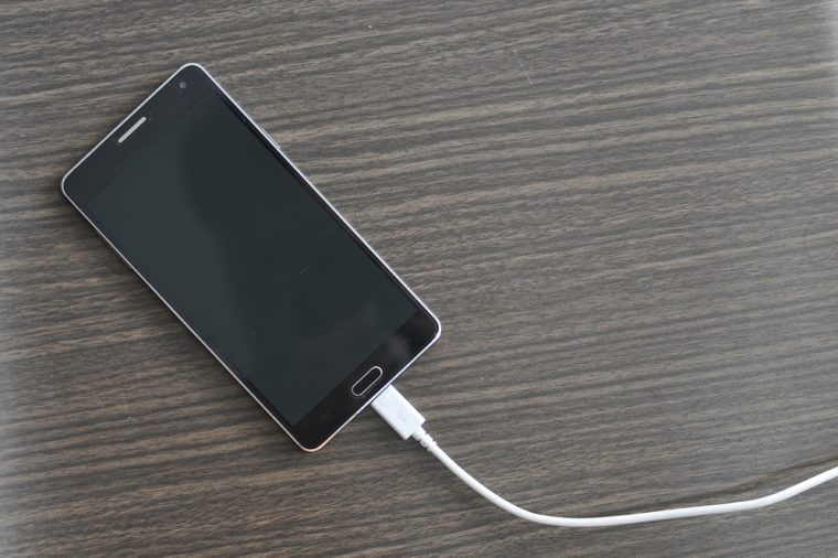 Smart phone Charging On Wood background
