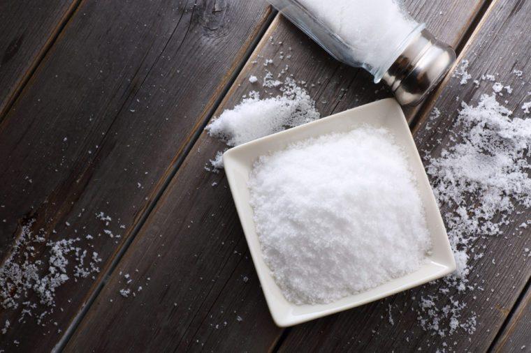 salt shaker on wooden table