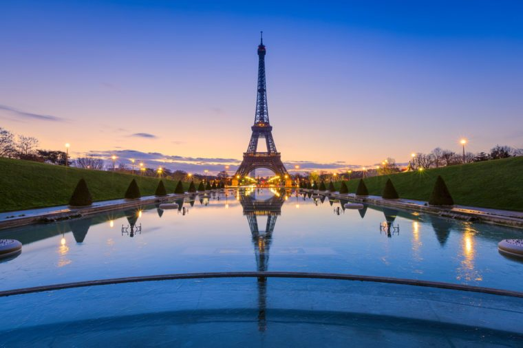 Frozen reflections in Paris. Eiffel Tower at sunrise from Trocadero Fountains