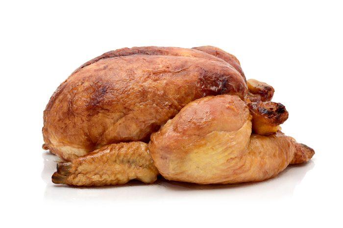 a roast turkey or a roast chicken on a white background