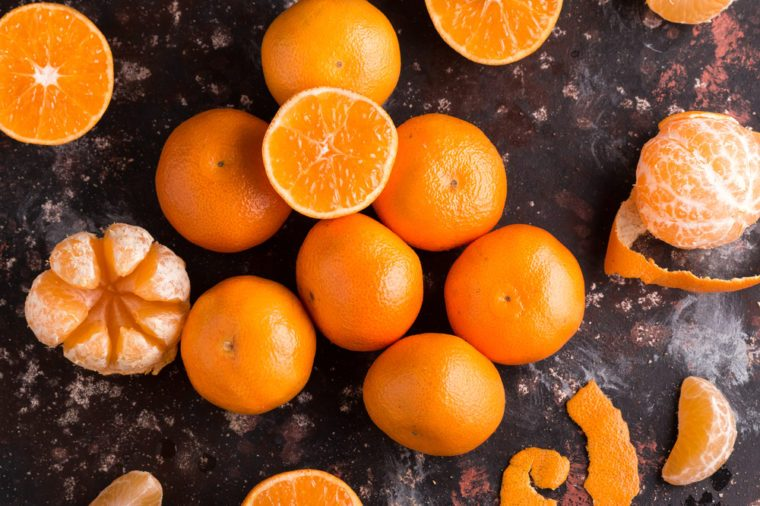 Fresh colorful Mandarins oranges on the Dark Background. Citrus background