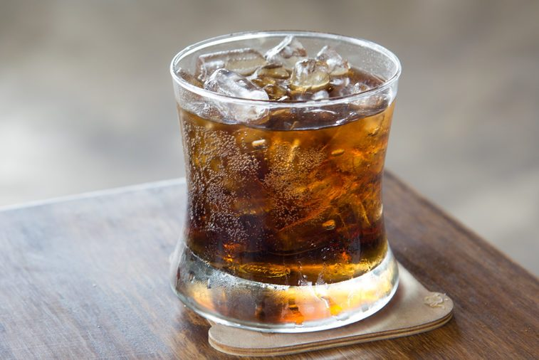 A glass of cola with ice for Cool off in the summer.