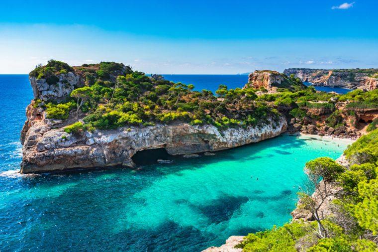 Beautiful beach bay with tropical turquoise water, Cala des Moro, Majorca island, Spain Mediterranean Sea.