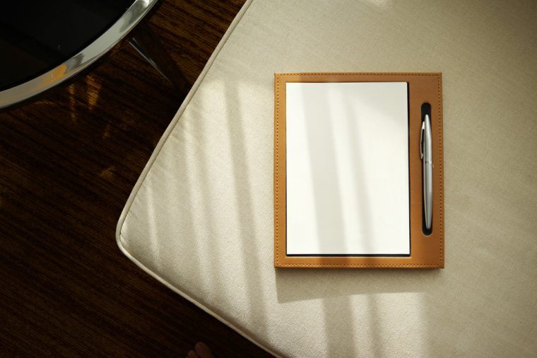 Notebook / notepad with pen on a cozy sofa