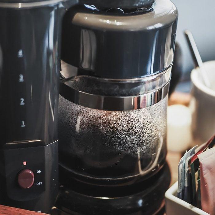 Making drip black coffee by Coffee Maker Machine