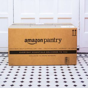 September 26, 2017. London. Amazon pantry online purchase delivery box just arriving to a home address.