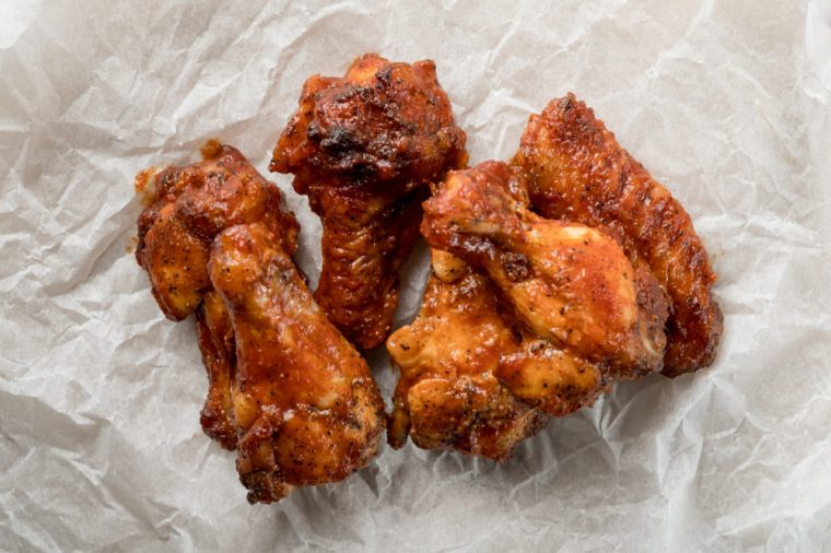 Baked BBQ Chicken Wings. Fast food menu background. Flat top view, from above.