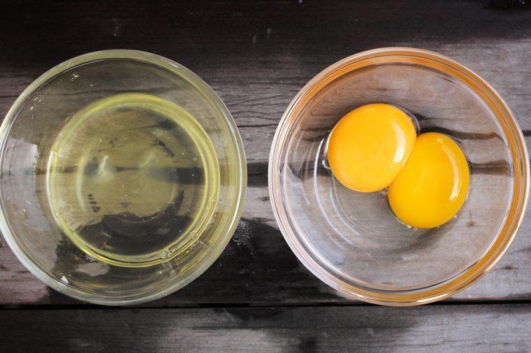 Separates yolk and white eggs