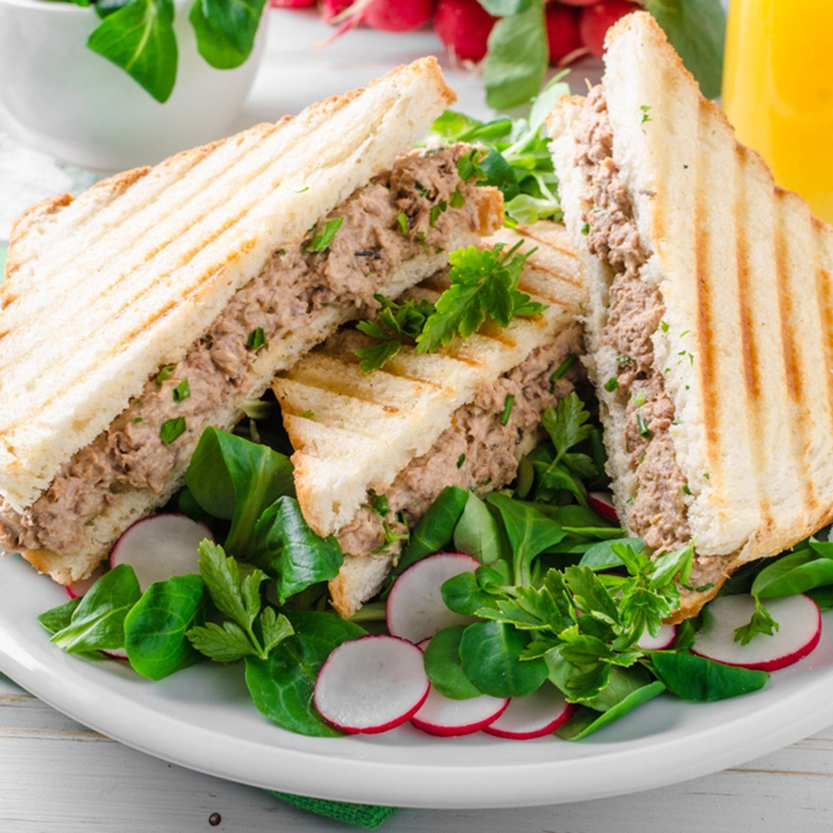Tuna salad sandwitch with lamb's lettuce and radishes