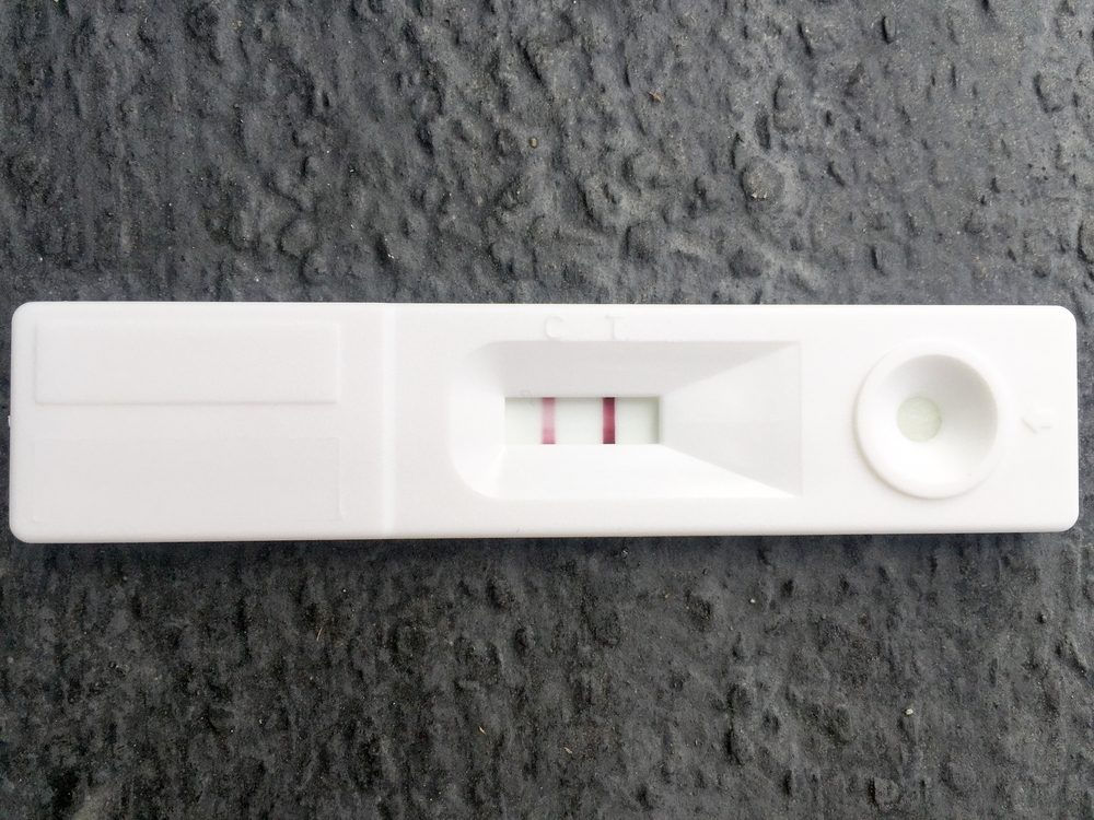 Pregnancy test on dark gray background. positive result.