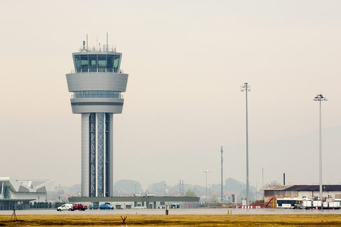 Airport control tower at Sofia's airport in a foggy weather.