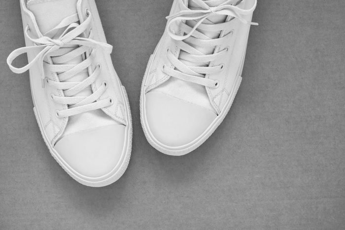 beautiful and convenient new gym shoes or sports shoes closeup on an empty and clean background and the place for the text