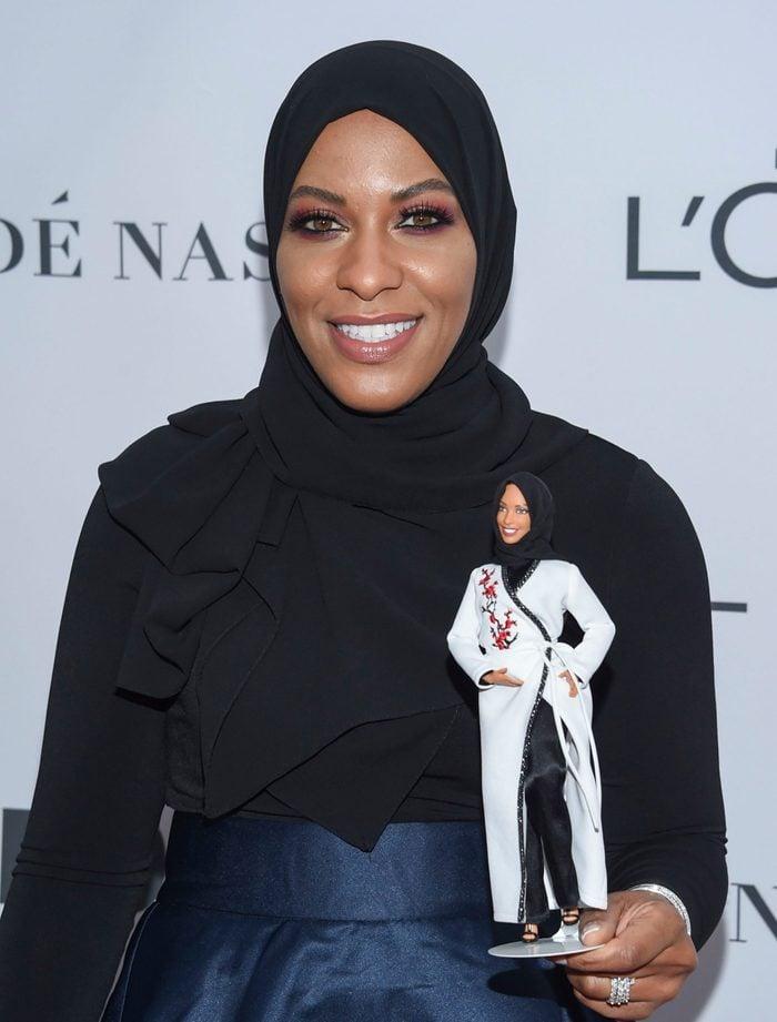 "Ibtihaj Muhammad holds a hijab-wearing ""Barbie Shero"""