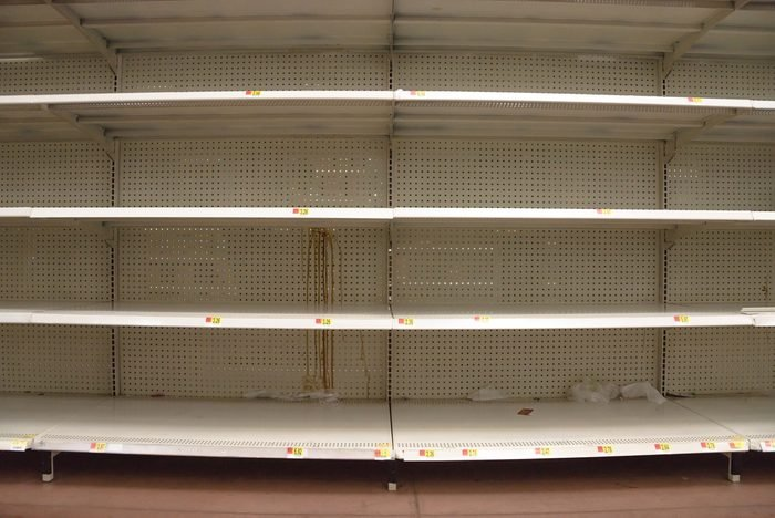 Empty shelves in store in Humble, Texas USA. Supermarket with empty shelves for goods.