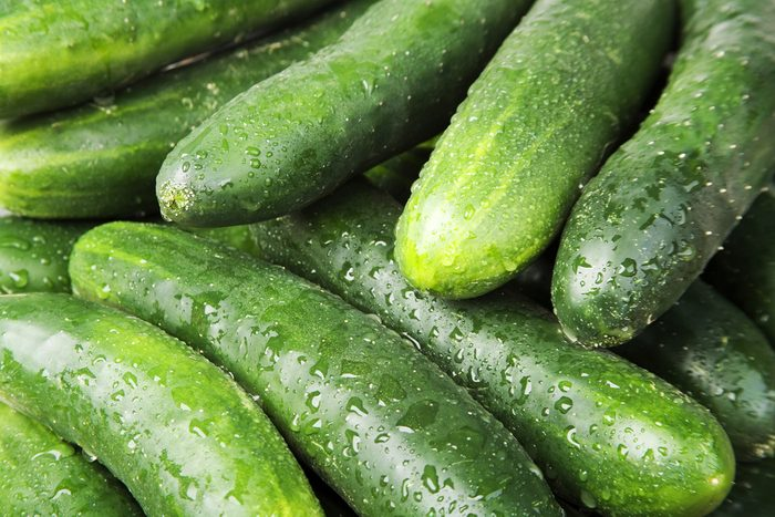 Closeup of several green cucumbers filling the frame