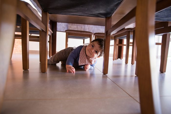 beautiful baby boy under the table
