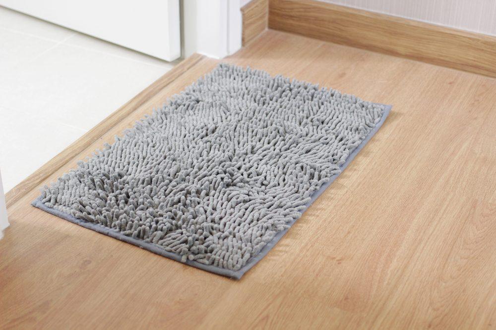 Fluffy gray doormat on the wood floor