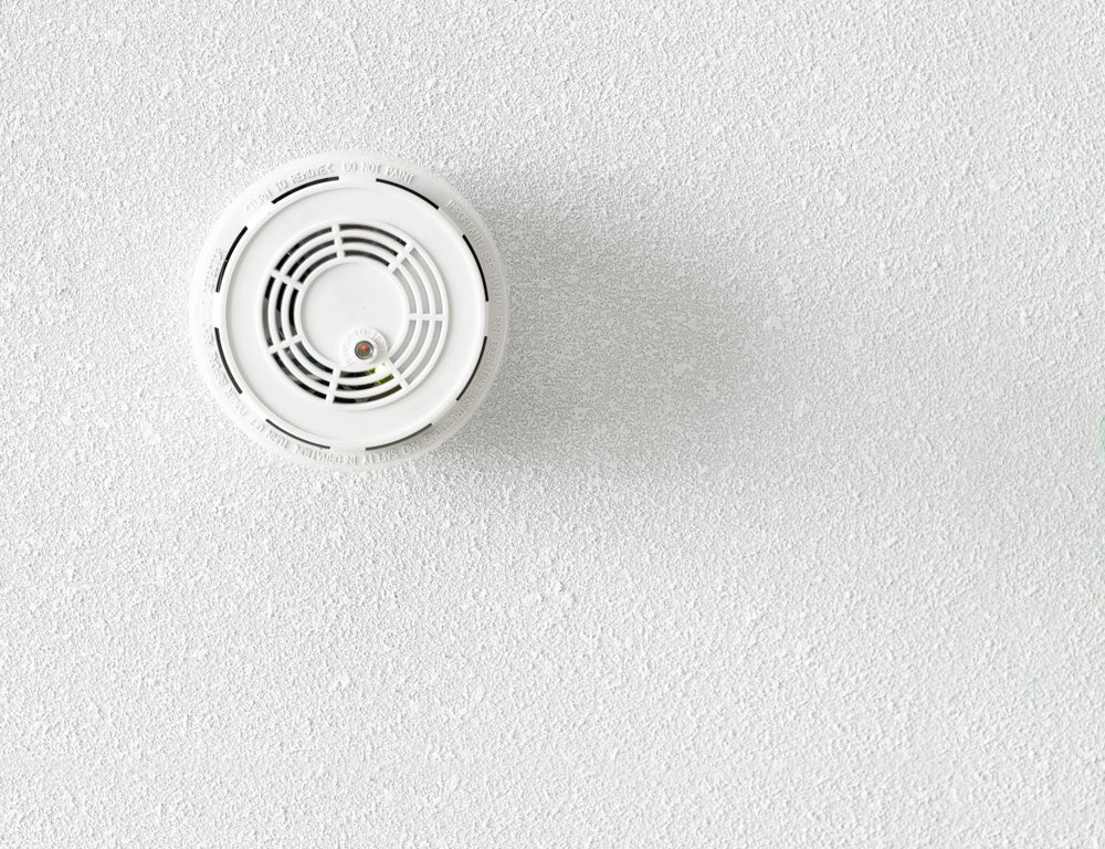 Fire and smoke alarm detector on the rough background