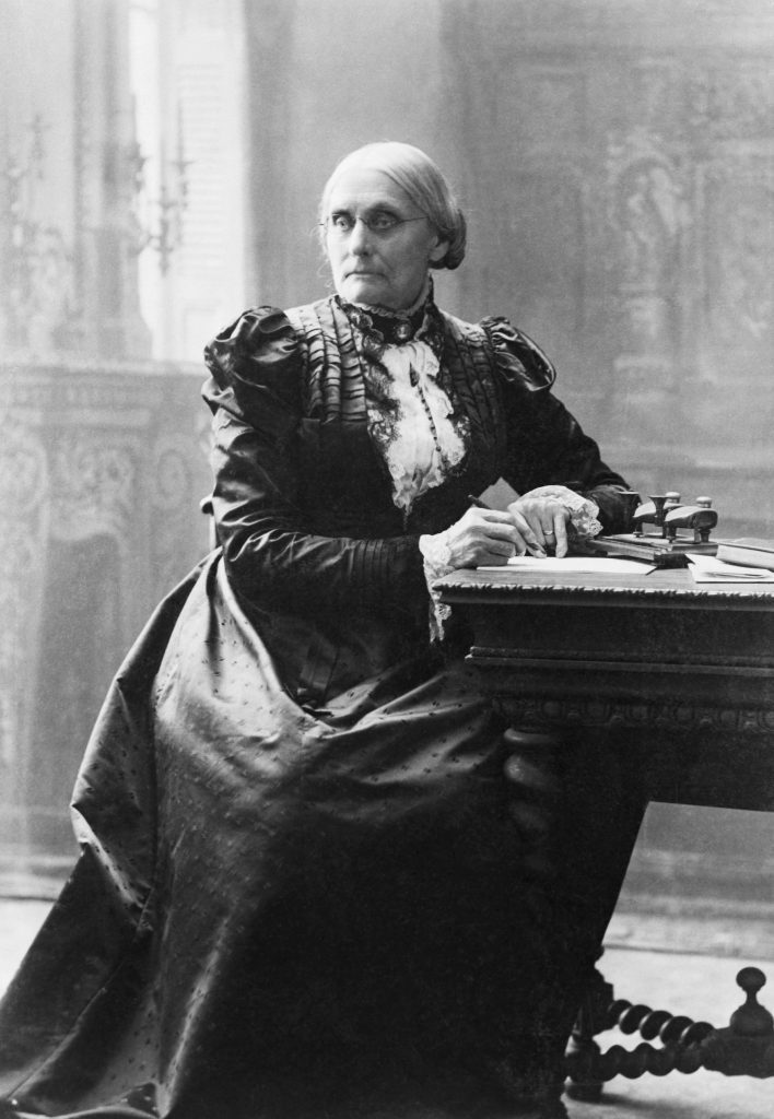 Suffragist Susan B. Anthony (1820-1906), seated at her desk.