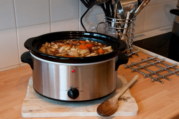 Slow cooker cooking Scouse in a Kitchen with some kitchen items in view
