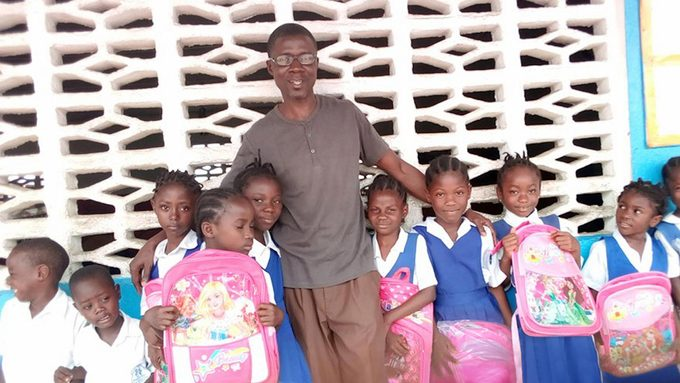 Man in Liberia helps people in his area.