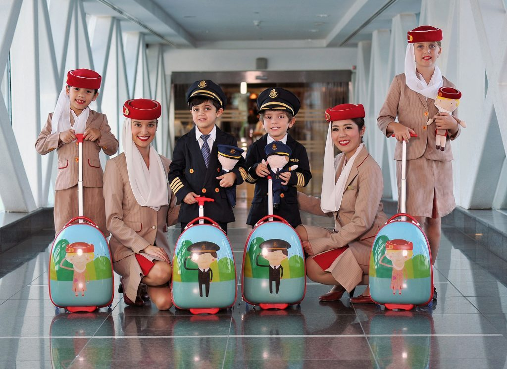 flight attendant emirates with children