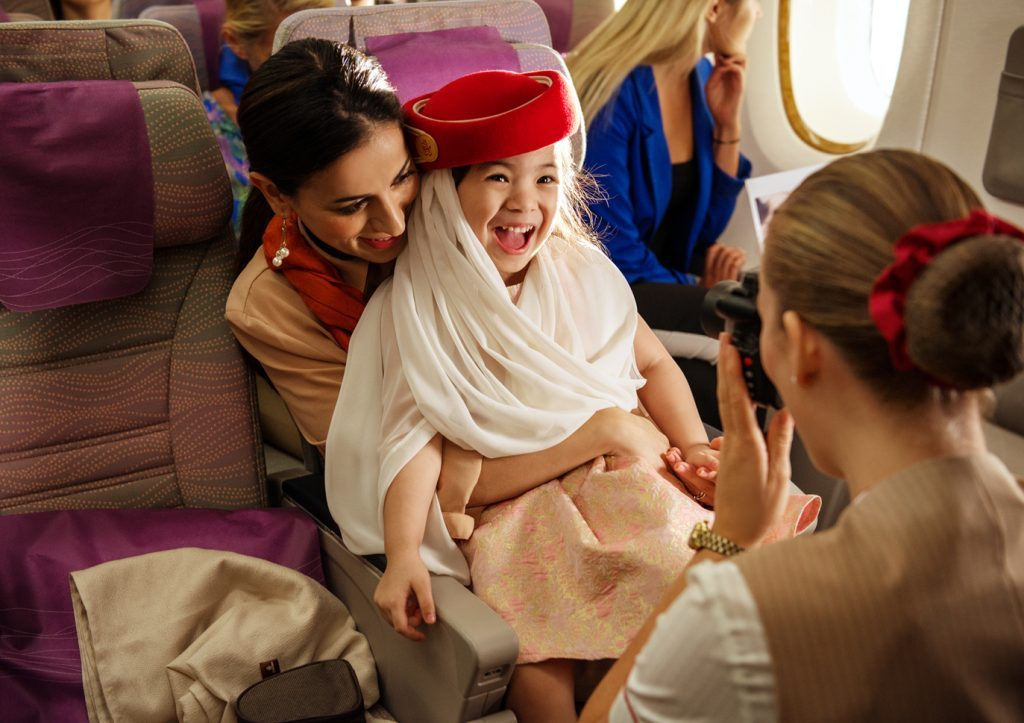 flight attendant with child emirates