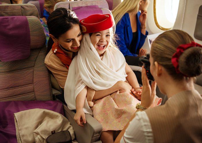 flight attendant with child emirates