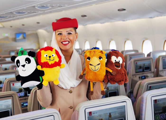 flight attendant with toys emirates
