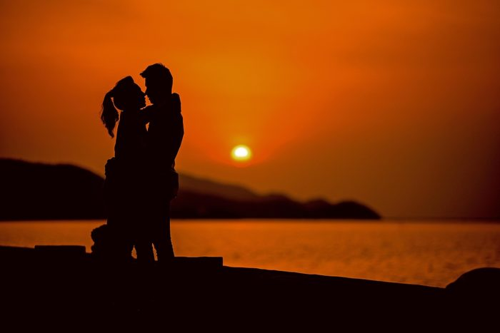 Sillhouette of lover on beach with sunset , sillhouette couple love