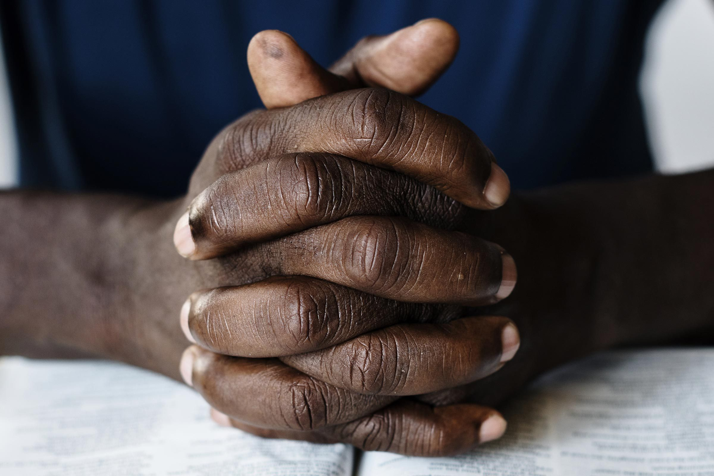 african hands folded