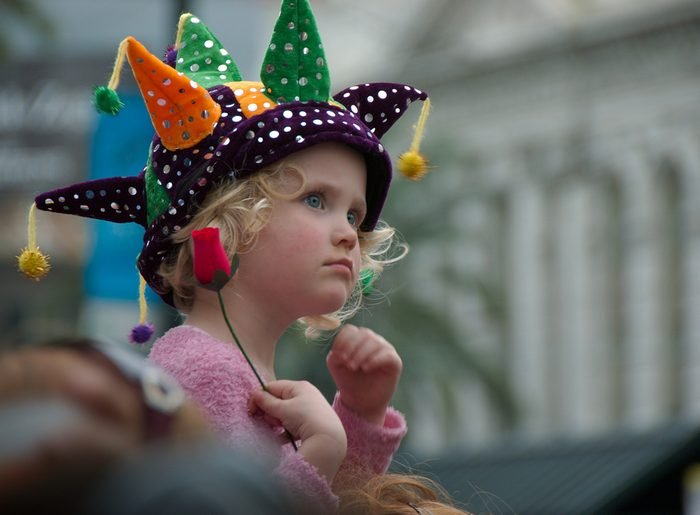 New Orleans, Louisiana, USA - 2016: A girl watches a parade during the Mardi Gras celebrations.