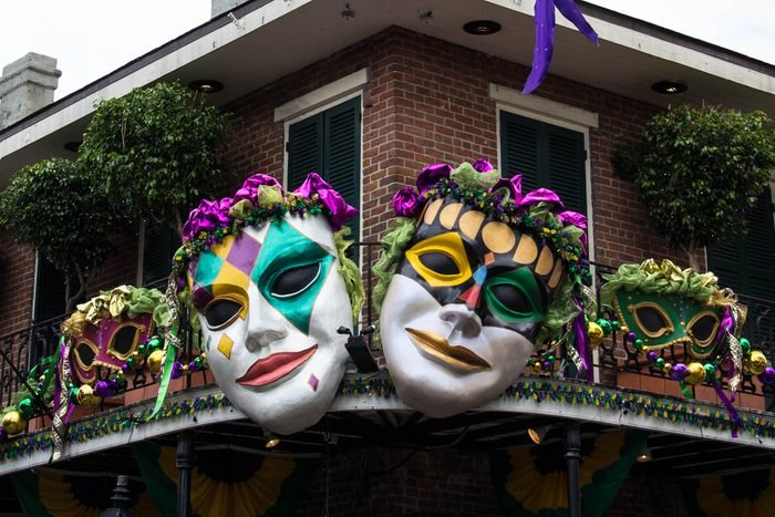 NEW ORLEANS, LOUISIANA,USA - FEBRUARY 8: Brightly colored masks adorn a railing in the French Quarter as Mardi Gras approaches in New Orleans on February 8, 2013.