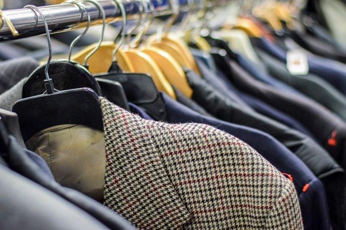 Rack of men's suit jackets hanging in boutique store