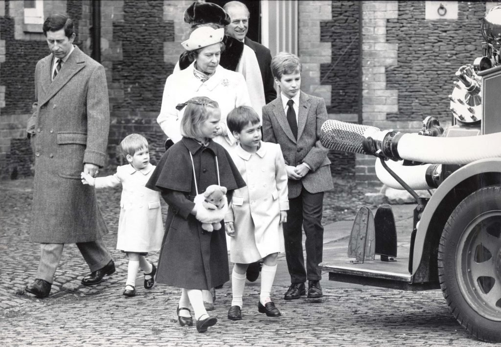 Royals At Sandringham 1988. The Queen Elizabeth Ii And Prince Philip With Their Grandchildren Prince''s Harry And William With Master Peter Phillips And Sister Zara And The Prince And Diana Princess Of Wales Looking On At A Vintage Fire Engine In The