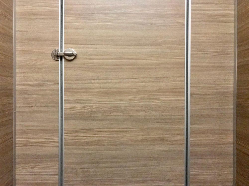 Stainless steel door knob, closed wooden door, locked door, public toilet door