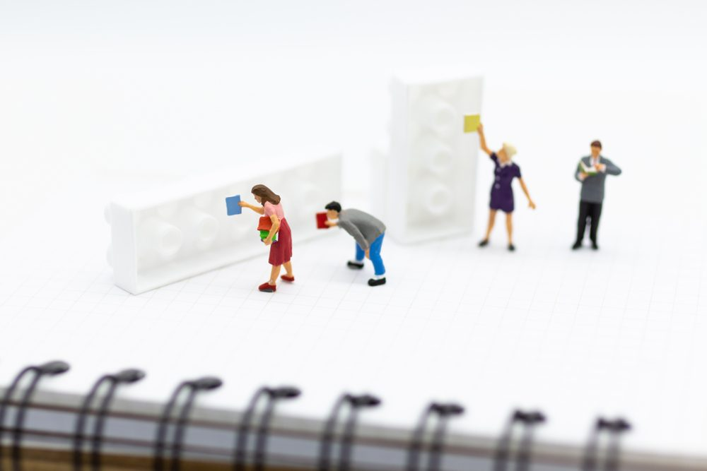 Miniature people: Student group reading books at the library. Image use for education concept.
