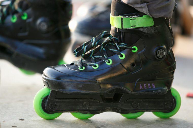 ODESSA,UKRAINE-21 AUGUST,2017:Aggressive in-line skates on roller skater feet.USD Aeon skates for extremal aggressive skating.Professional roller blades for extreme tricks