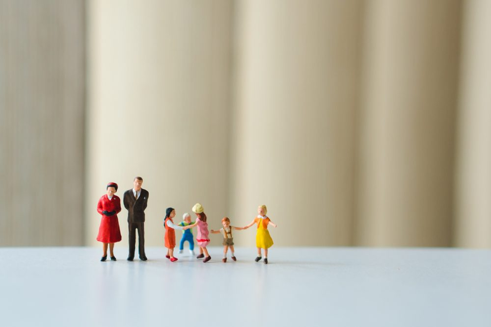 Miniature people, happy family playing together using as family concept