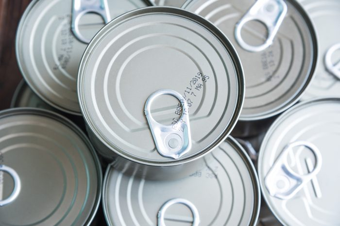 Closeup Of A Group Of Aluminium Cans On Wooden Background, Top View.