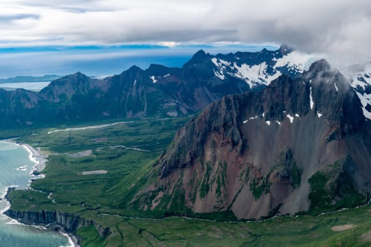 Aerial view of the volcanoes and Aleutian Range of mountains in Southwest Alaska on a clear day