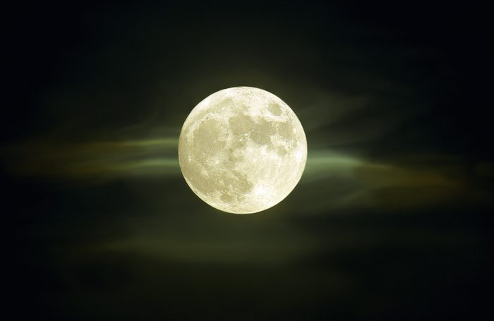Full moon with clouds at summer midnight