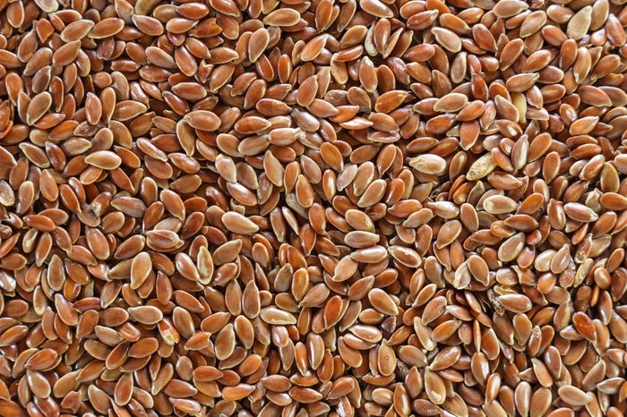 Brown flax seed full background.