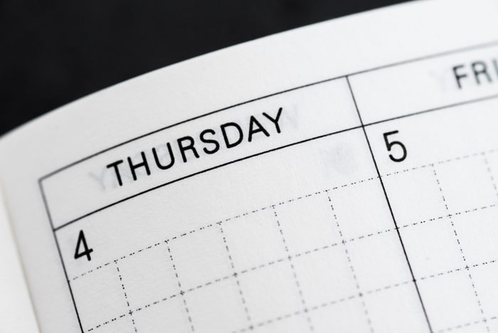 Thursday, days of the week. Black and white macro shot of monthly planner - Image