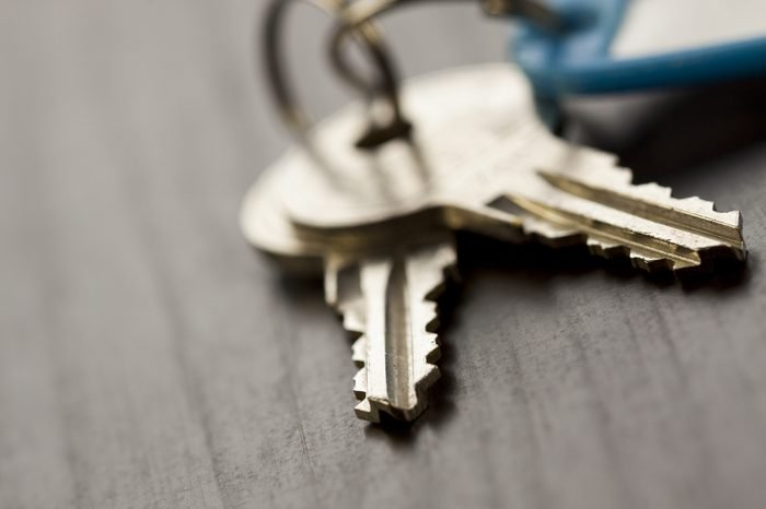 Macro Shot of Conceptual House Keys on Top of Wooden Table