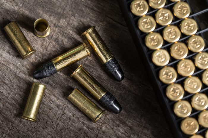 Scattering of small caliber cartridges on a wooden background