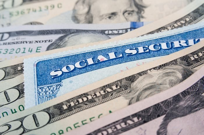 Social security card and American money dollar bills close up concept