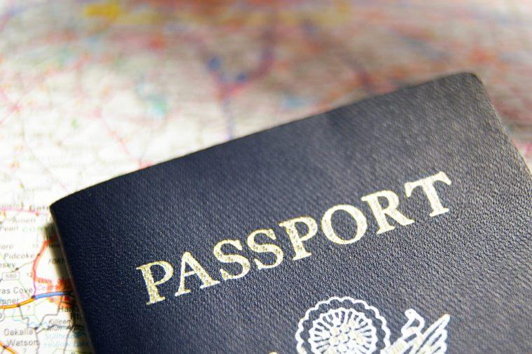 closeup of a US passport on a map