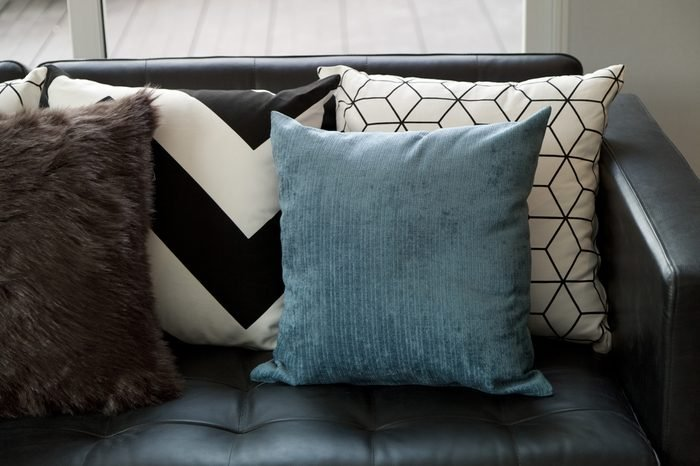 blue pillow on sofa at home.